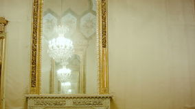 Beautiful hanging crystal chandelier reflection in mirror stock footage