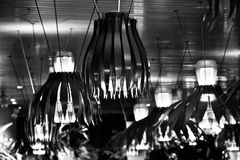 Stylish hanging interior lights of a food court isolated unique photo. A beautiful hanging food court lights isolated unique stock photograph stock photo