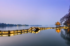 Beautiful hangzhou in sunset and ancient pavilion Royalty Free Stock Photography