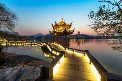 Beautiful hangzhou in sunset and ancient pavilion Royalty Free Stock Photo