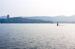 Beautiful Hangzhou West lake scenery, Leifeng pagoda in afterglow. Stock Photos