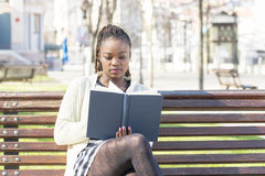 Beautiful happiness african young woman read book in the park. Stock Photo