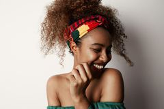 Beautiful happy african american girl with an curly afro hairstyle smiling.  royalty free stock photography