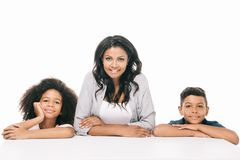 Happy african american mother with kids. Beautiful happy african american mother with adorable children smiling at camera isolated on white stock image