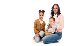 Beautiful happy african american mother with adorable little kids smiling at camera. On white royalty free stock photo