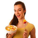 Beautiful happy asian caucasian woman in yellow t shirt eating f Stock Photo