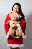 Beautiful happy asian girl in Santa Claus clothes Stock Photos
