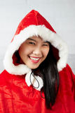 Beautiful happy asian girl in Santa Claus clothes.  Stock Image