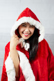 Beautiful happy asian girl in Santa Claus clothes.  Stock Photography