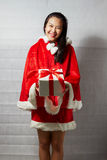 Beautiful happy asian girl in Santa Claus clothes.  Royalty Free Stock Images