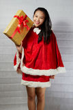 Beautiful happy asian girl in Santa Claus clothes.  Royalty Free Stock Photos