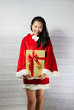 Beautiful happy asian girl in Santa Claus clothes.  Stock Photo