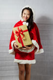Beautiful happy asian girl in Santa Claus clothes.  Stock Photos