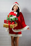 Beautiful happy asian girl in Santa Claus clothes.  Royalty Free Stock Image