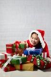 Beautiful happy asian girl in Santa Claus clothes.  Stock Photos