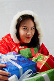 Beautiful happy asian girl in Santa Claus clothes Stock Photos