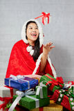 Beautiful happy asian girl in Santa Claus clothes Stock Image