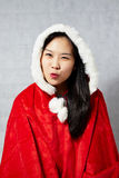 Beautiful happy asian girl in Santa Claus clothes Royalty Free Stock Photography