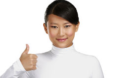 Beautiful happy asian girl showing thumbs up Royalty Free Stock Images