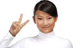 Beautiful happy asian girl showing victory positive sign Royalty Free Stock Photo
