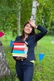 Beautiful happy asian woman girl teacher student holding heavy b Stock Photos