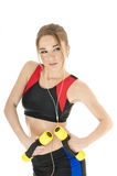 Beautiful  happy athletic  girl  with dumbbells. Royalty Free Stock Photo
