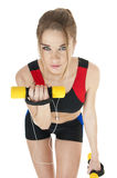 Beautiful  happy athletic  girl  with dumbbells  covering white Royalty Free Stock Photos