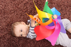 Beautiful and happy baby. With wind mill Stock Image