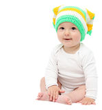 Beautiful happy baby boy sitting on bed. Beautiful happy baby boy sitting on white bed Royalty Free Stock Photos