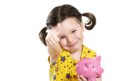 Beautiful happy baby girl holding a pretty piggybank Stock Image
