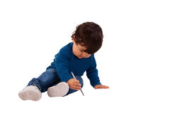 Beautiful and happy baby writing on floor Stock Images