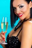 Beautiful happy black hair girl holding glass of champagne. Stock Photo