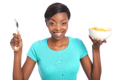 Beautiful happy black woman with breakfast cereal Royalty Free Stock Images