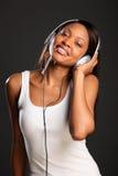 Beautiful happy black woman enjoying music Royalty Free Stock Image