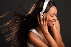 Beautiful happy black woman listening to music Royalty Free Stock Image
