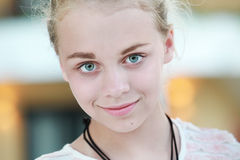 Beautiful happy blond Caucasian teenage girl royalty free stock photography