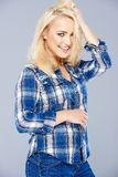 Beautiful happy blond girl in blue jeans Stock Photo