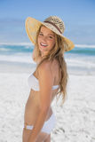 Beautiful happy blonde on the beach in white bikini and sunhat Stock Images