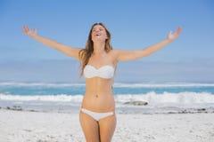 Beautiful happy blonde on the beach in white bikini Royalty Free Stock Photo
