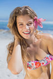 Beautiful happy blonde with flower hair accessory on the beach Stock Photo
