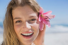 Beautiful happy blonde with flower hair accessory on the beach Stock Photos