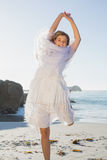 Beautiful happy blonde in white sundress and scarf on the beach Royalty Free Stock Photos