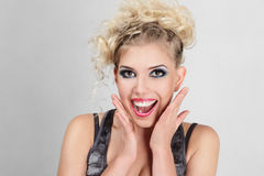 Beautiful happy blonde young woman Stock Photography
