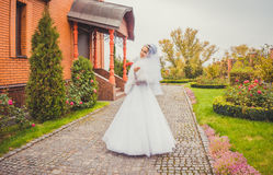 Beautiful happy bride on background of autumn Park Royalty Free Stock Images