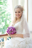 Beautiful happy bride in her wedding dress Stock Photography