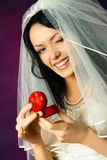 Beautiful happy bride holding a wedding ring Stock Images