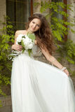 Beautiful happy bride with  long wavy hair and wed Royalty Free Stock Photos