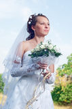 Beautiful happy bride looks down Royalty Free Stock Photography