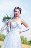 Beautiful happy bride looks down Stock Photo