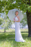Beautiful Happy bride with parasol Stock Photography